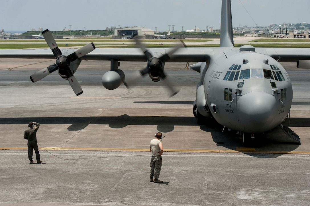 A C-130H Hercules assigned to Yokota Air Base, starts its engines July 28, 2016, at Kadena Air Base, Japan. As the keystone of the Pacific, Kadena AB supports a wide range of contingency and humanitarian operations throughout the Indo-Asia Pacific region. (U.S. Air Force photo by Senior Airman Peter Reft)