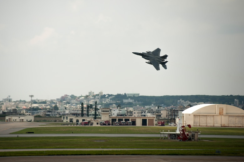 An F-15 Eagle assigned to the 44th Fighter Squadron performs a flyby over the flight line July 28, 2016, at Kadena Air Base, Japan. The 18th Wing hosts a fleet of 81 combat-ready aircraft and remains at constant readiness to respond at a moment's notice to crisis and conflict anywhere in the Indo-Asia Pacific region. (U.S. Air Force photo by Senior Airman Peter Reft)