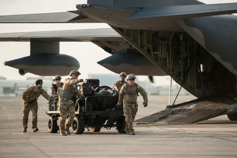 Airmen from the 18th Logistics Readiness Squadron forward area refueling point team and 1st Special Operations Squadron unload a forward area manifold cart from an MC-130H Combat Talon II July 28, 2016, at Kadena Air Base, Japan. The 18th LRS conducted a hot refueling exercise on the flight line to demonstrate forward operations capability. (U.S. Air Force photo by Senior Airman Peter Reft)