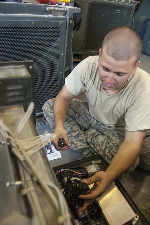 U.S. Air Force Senior Airman Todd Gonsalves, 786th Civil Engineer Squadron (CES) heating, ventilation and air conditioning (HVAC) journeyman, repairs an air conditioning unit July 28, 2016, at Incirlik Air Base, Turkey. HVAC repair technicians came to Incirlik as a result of a request for forces from the 39th CES after the July 15, 2016 failed Turkish military coup. (U.S. Air Force photo by Staff Sgt. Jack Sanders)