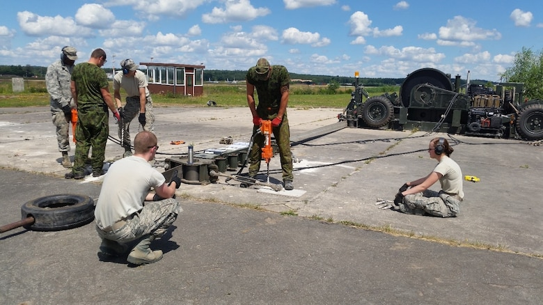 Airmen from the 435th Construction and Training Squadron and Lithuanian air force participate in a training exercise with a Mobile Aircraft Arresting System July 20, 2016, at Ramstein Air Base, Germany. These training opportunities not only serve to educate U.S. Air Force partners and provide them with world-class training, but also serve to bring the U.S. and its allies together at the lowest levels to form relationships and learn from each other. (U.S. Air Force courtesy photo)