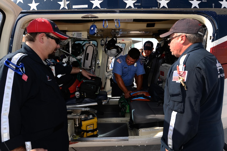 Airmen from both the 82nd Civil Engineer Squadron fire department look inside the Air Evac Lifeteam 34 helicopter during a familiarization tour at Sheppard Air Force Base, Texas, Aug. 3, 2016. Chris Whitmus, an Air Evac Lifeteam 34 pilot, gives a medical air evacuation training session to more than 25 Airmen showing them how to properly set up and navigate a landing zone during an emergency. (U.S. Air Force photo by Senior Airman Kyle E. Gese/Released)