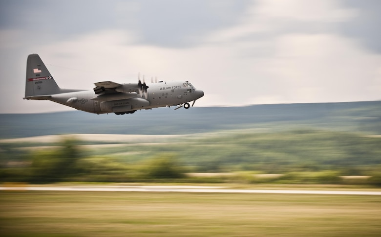 A C-130H Hercules, from the 179th Airlift Wing at Mansfield Lahm Air National Guard Base, Ohio, takes off to perform an airdrop during exercise Slovak Warthog, July 27, 2016, at Sliač Air Base, Slovakia. Members of the U.S. and Slovak armed forces joined together for the exercise to demonstrate joint operations with a variety of aircraft. (U.S. Air National Guard photo/Staff Sgt. William Hopper)