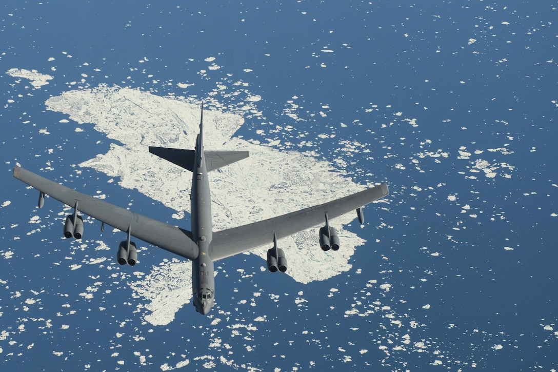 A B-52 Stratofortress, from Minot Air Force Base, N.D., flies near the North Pole, July 31, 2016, during Polar Roar, a strategic deterrence exercise. The rapid global mobility and air refueling capabilities of Air Mobility Command and the 305th Air Mobility Wing ensured the B-52's were able to complete their mission. (U.S. Air Force photo/Senior Airman Joshua King)