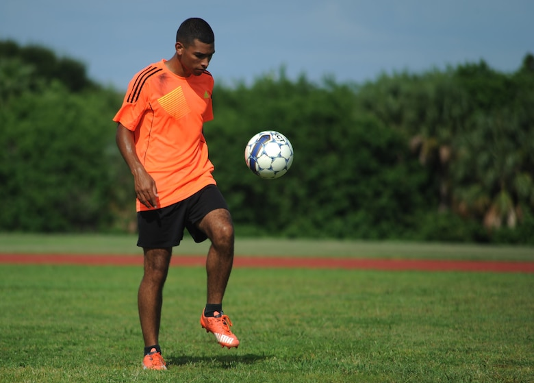 Senior Airman Geovanni Lee, a Milstar technician assigned to the 6th Communications Squadron, juggles a soccer ball during a practice session at MacDill Air Force Base, Fla., August 3, 2016. Lee is one of the captains of the MacDill Football Club, a local soccer team competing in an upcoming national military tournament. (U.S. Air Force photo by Airman Adam R. Shanks)