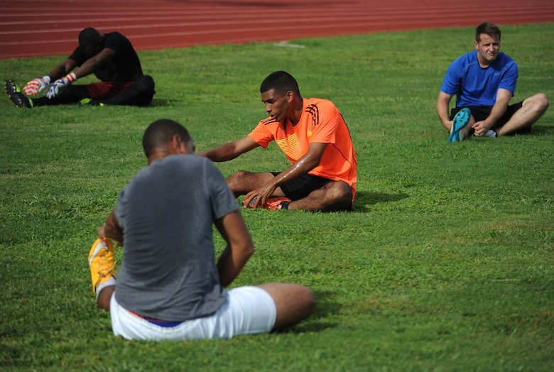 Members of MacDill Football Club stretch before training drills during a team practice at MacDill Air Force Base, Fla., August 3, 2016. The team is preparing to compete in the Defender's Cup, a national military tournament hosted at Lackland AFB, Texas September 2, 2016. (U.S. Air Force photo by Airman Adam R. Shanks)