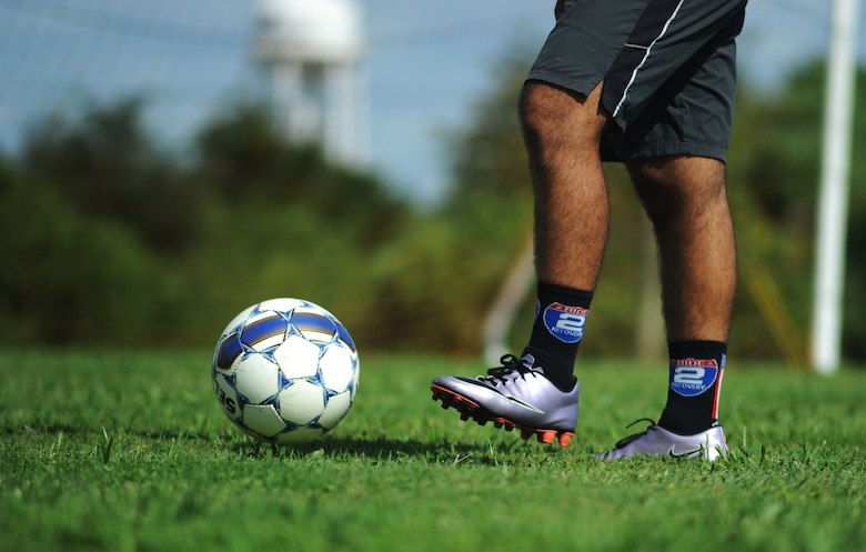 Senior Airman Matthew Potter, a KC-135 Stratotanker crew chief assigned to the 6th Maintenance Squadron, passes a soccer ball during a practice session at MacDill Air Force Base, Fla., August 3, 2016. The MacDill Football Club, comprised of MacDill's service members, is training in preparation for the Defender's Cup National Military Tournament at Lackland AFB, Texas September 2, 2016. (U.S. Air Force photo by Airman Adam R. Shanks)