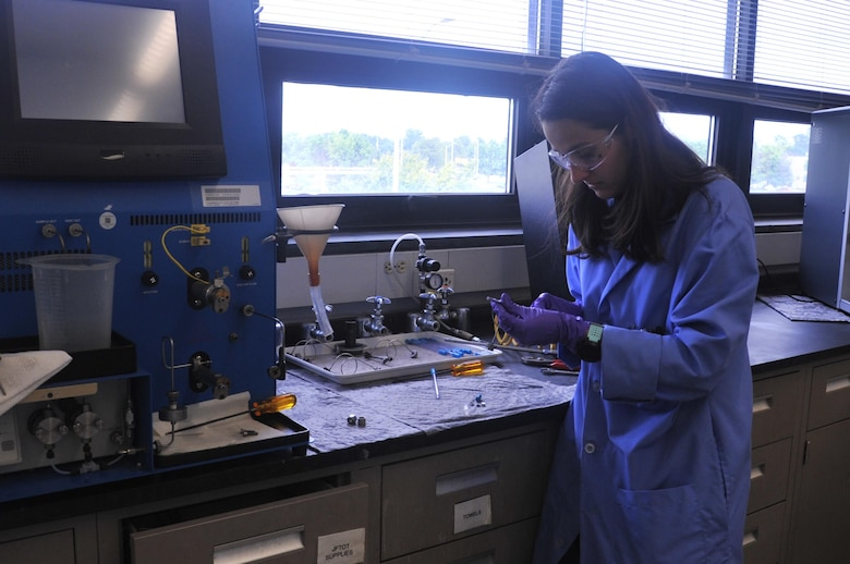 Zulmarie Jimenez, a chemist at the AFPET Fuels Lab, checks the thermal stability of a jet fuel. (U.S. Air Force photo/Sandy Simison)
