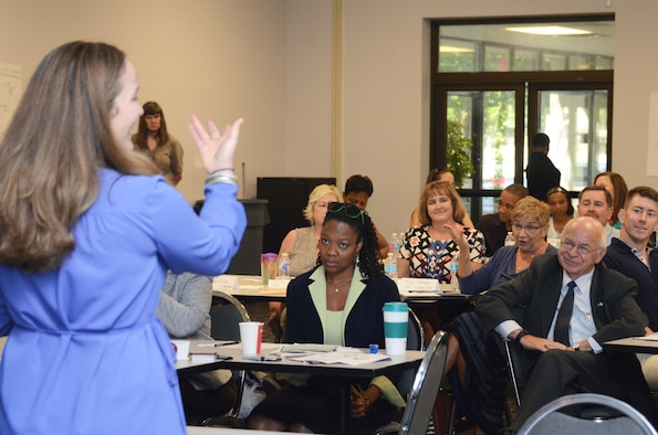 Laura Chiang from the Center for Disease Control and prevention, interacts with a group of participants during a discussion on barriers to effective prevention at the Primary Prevention of Violence Foundation Training seminar held on Dobbins Air Reserve Base, Ga. July 19, 2016. The 10-day training program held 18-29 July, involved guest speakers from Headquarters Air Force, CDC and Green Dot. (U.S. Air Force photo/Don Peek)