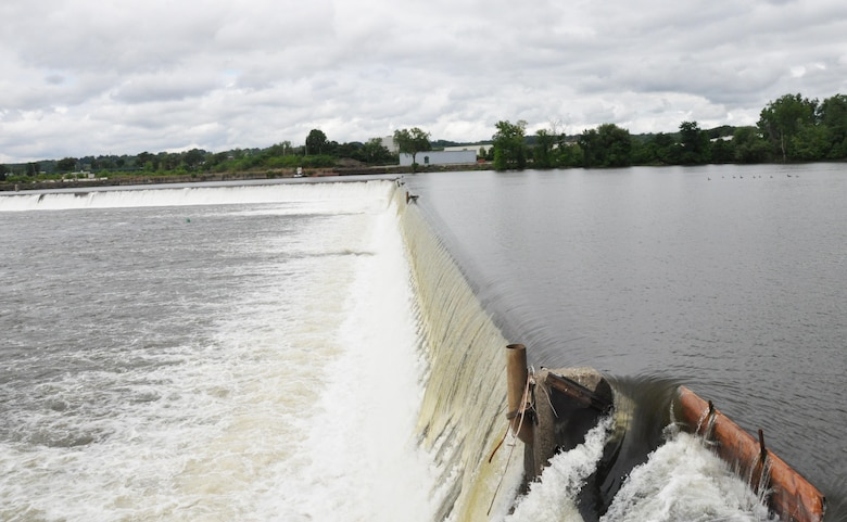 Hudson River water spilling over the dam portion of the Troy Lock and Dam in Troy, New York.