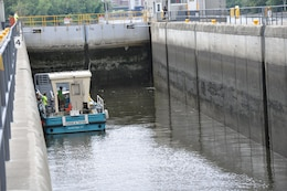 A vessel traveling through the Troy Lock and Dam.