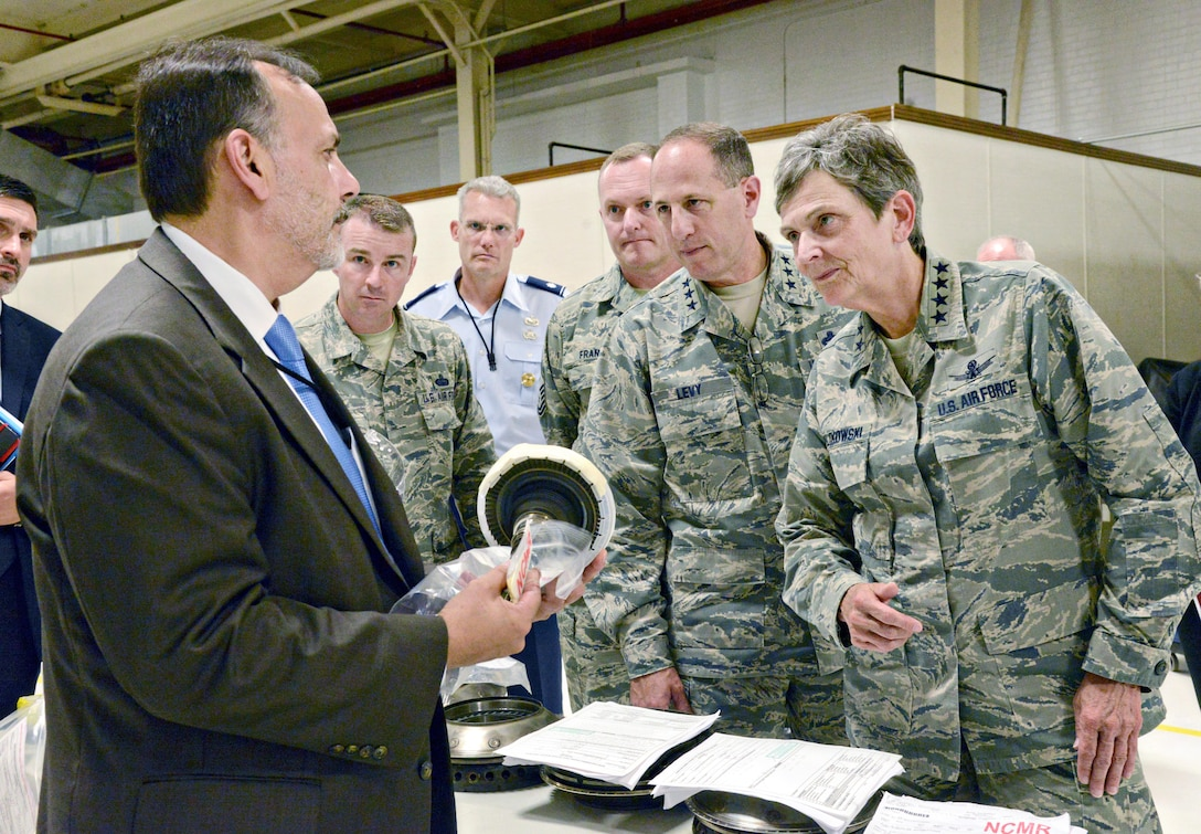 Ralph Garcia, Air Force Life Cycle Management Center director of Propulsion, discusses F107 engine production challenges with Air Force Materiel Command Commander Gen. Ellen Pawlikowski during her visit to Tinker AFB July 18.