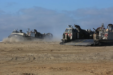 A U.S. Navy pilot positions Landing Craft Air Cushion 73 next to Landing Craft Air Cushion 48 during amphibious assault training on Camp Pendleton, Calif., August 2, 2016. The LCAC carries cargo, vehicles like high mobility multi-purpose wheeled vehicles and M1A1 Abrams tanks, and personnel for ship to shore movements. (U.S. Marine Corps photo by Lance Cpl. Shellie Hall)