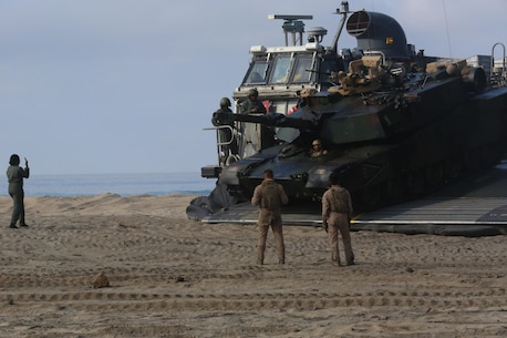 A Marine with 1st Tank Battalion, 1st Marine Division drives an M1A1 Abrams tank off of a Landing Craft Air Cushion with Assault Craft Unit 5 during the amphibious assault training portion of a Marine Corps Combat Readiness Evaluation on Camp Pendleton, Calif., August 2, 2016. During a MCCRE, Marines perform various events to determine the combat readiness of the unit. The LCAC is the only vehicle capable of transporting an M1A1 Abrams tank from an amphibious ship to land. (U.S. Marine Corps photo by Lance Cpl. Shellie Hall)