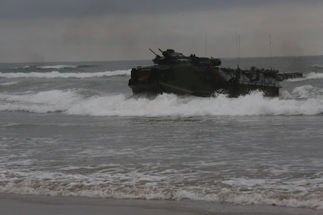 Marines with 3rd Battalion, 1st Marine Regiment approach the shore in an amphibious assault vehicle as part of a Marine Corps Combat Readiness Evaluation on Camp Pendleton, Calif., August 2, 2016. During a MCCRE, Marines perform various events to determine the combat readiness of the unit. (U.S. Marine Corps photo by Lance Cpl. Shellie Hall)
