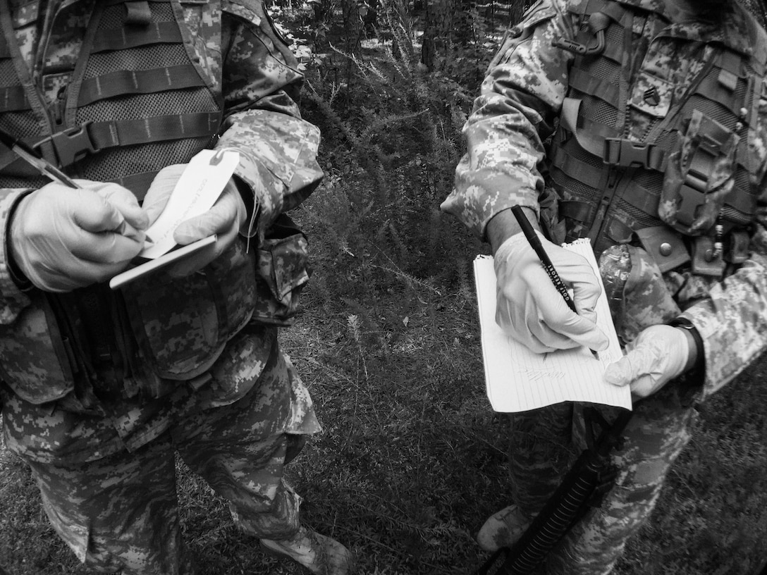 U.S. Army Reserve soldiers with the 246th Quartermaster Company (Mortuary Affairs), Mayaguez, Puerto Rico, mark personal effects and sketch the location during a search and recovery mission at a simulated helicopter crash during Mortuary Affairs Exercise 16-02, July 21, at Fort Pickett, Va. MAX 16-02 included all six U.S. Army Reserve Mortuary Affairs units performing search and recovery missions and operating Mortuary Affairs Collection Points and a Theater Mortuary Evacuation Point. The units were evaluated by active-duty mortuary affairs personnel from nearby Fort Lee, Va. (U.S. Army photo by Timothy L. Hale)(Released)