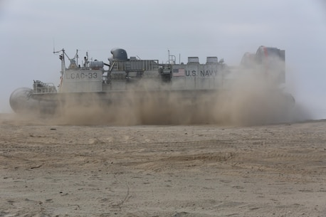 A U.S. Navy Landing Craft Air Cushion with Assault Craft Unit 5 lands during the amphibious assault training portion of a Marine Corps Combat Readiness Evaluation on Camp Pendleton, Calif., August 2, 2016. During a MCCRE, Marines perform various events to determine the combat readiness of the unit. The LCAC carries cargo, vehicles including high mobility multi-purpose wheeled vehicles and M1A1 Abrams tanks, and personnel for ship to shore movements.  (U.S. Marine Corps photo by Lance Cpl. Shellie Hall)