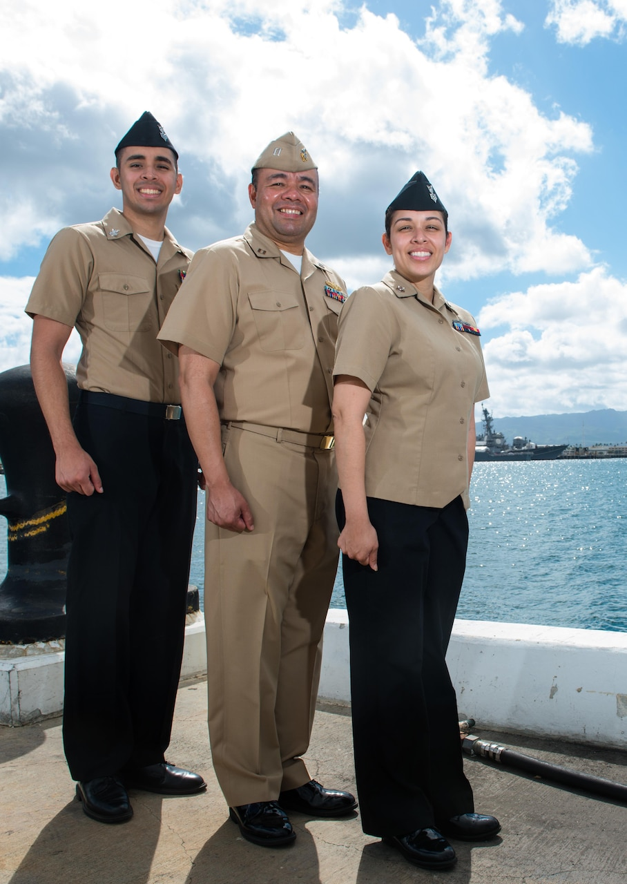 160729-N-LY160-052 JOINT BASE PEARL HARBOR-HICKAM (July 29, 2016) - Intelligence Specialist 1st Class John Pacheco, left, Lt. John Pacheco, middle, and Intelligence Specialist 1st Class Christine Smith pose for a photo at Commander, Submarine Force U.S. Pacific Fleet in Joint Base Pearl Harbor-Hickam. Twenty-six nations, 49 ships, six submarines, about 200 aircraft, and 25,00 personnel are participating in RIMPAC from June 29 to Aug. 4 in and around the Hawaiian Islands and Southern California. The world's largest international maritime exercise, RIMPAC provides a unique training opportunity while fostering and sustaining cooperative relationships between participants critical to ensuring the safety of sea lanes and security on the world's oceans. RIMPAC 2016 is the 25th exercise in the series that began in 1971. (U.S. Navy photo by Mass Communication Specialist 2nd Class Michael H. Lee)