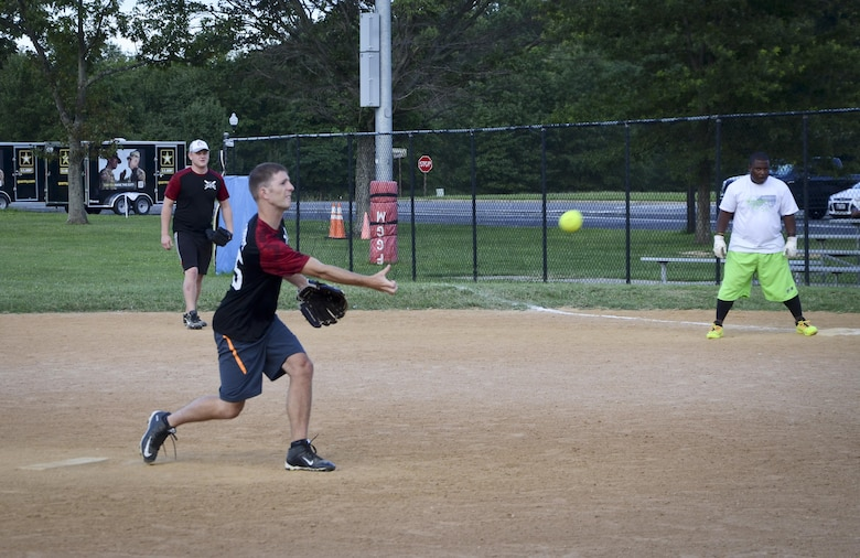The 34th Intelligence Squadron player delivers a pitch during the Game 1 Division ONE Intramural Softball Championship game against the Navy Information Operations Command, August 3, 2016 at Fort Meade, Md. NIOC won the first game 19 to 9 to force a Game 2 against the 34th IS. (U.S. Air Force photo/Staff Sgt. AJ Hyatt)