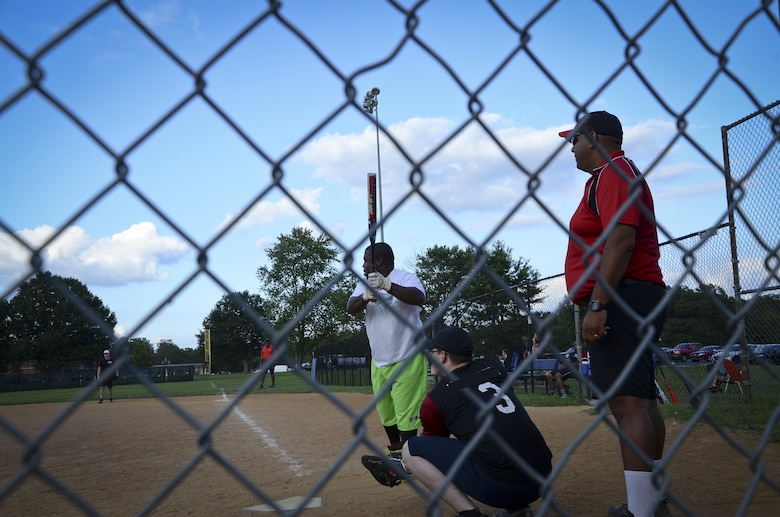 A Navy Information Operations Command player delivers a pitch during the Game 1 Division ONE Intramural Softball Championship game against the 34th Intelligence Squadron, August 3, 2016 at Fort Meade, Md. NIOC won the first game 19 to 9 to force a Game 2 against the 34th IS. (U.S. Air Force photo/Staff Sgt. AJ Hyatt)