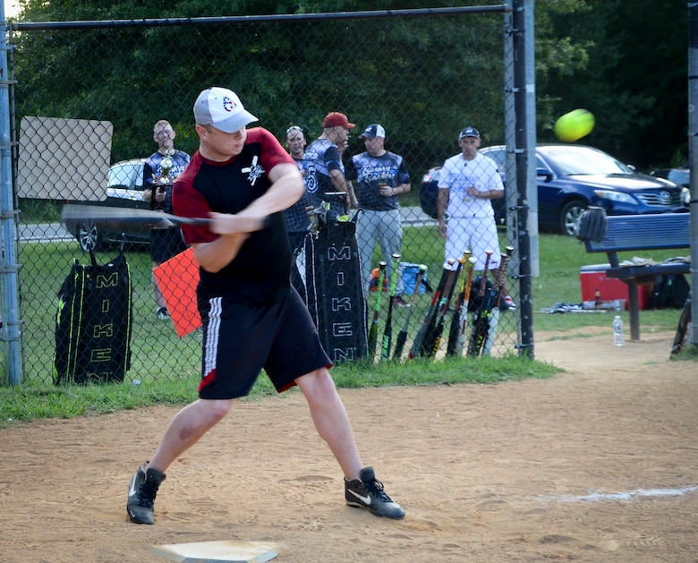 A 34th Intelligence Squadron player swings at a pitch during the Game 1 Division ONE Intramural Softball Championship game against the Navy Information Operations Command, August 3, 2016 at Fort Meade, Md. NIOC won the first game 19 to 9 to force a Game 2 against the 34th IS. (U.S. Air Force photo/Staff Sgt. AJ Hyatt)