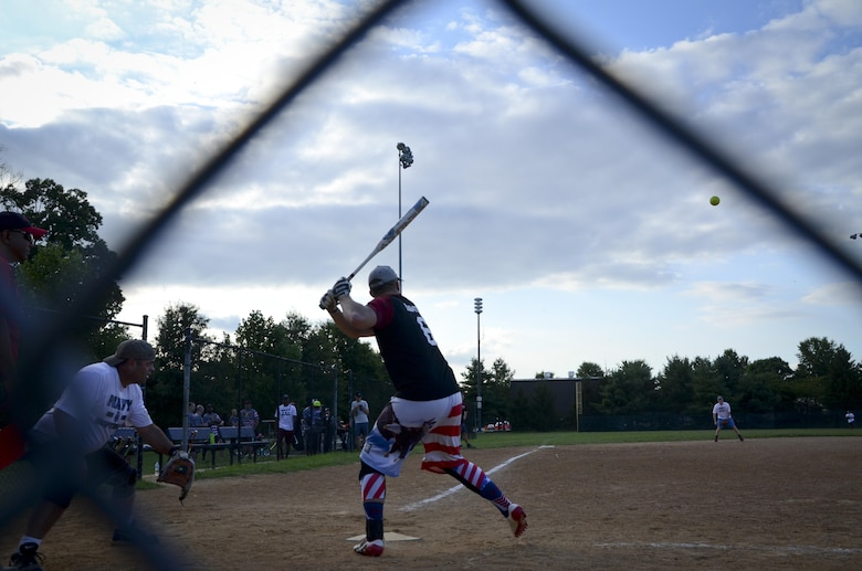 A 34th Intelligence Squadron player prepares to swing at a pitch during the Game 1 Division ONE Intramural Softball Championship game against the Navy Information Operations Command, August 3, 2016 at Fort Meade, Md. NIOC won the first game 19 to 9 to force a Game 2 against the 34th IS. (U.S. Air Force photo/Staff Sgt. AJ Hyatt)