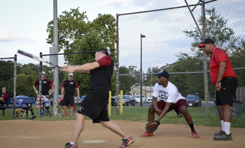 A 34th Intelligence Squadron player drives a ball during the Game 1 Division ONE Intramural Softball Championship game against the Navy Information Operations Command, August 3, 2016 at Fort Meade, Md. NIOC won the first game 19 to 9 to force a Game 2 against the 34th IS. (U.S. Air Force photo/Staff Sgt. AJ Hyatt)