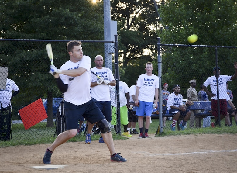 A Navy Information Operations Command prepares to swing during the Game 1 Division ONE Intramural Softball Championship game against the 34th Intelligence Squadron, August 3, 2016 at Fort Meade, Md. NIOC won the first game 19 to 9 to force a Game 2 against the 34th IS. (U.S. Air Force photo/Staff Sgt. AJ Hyatt)