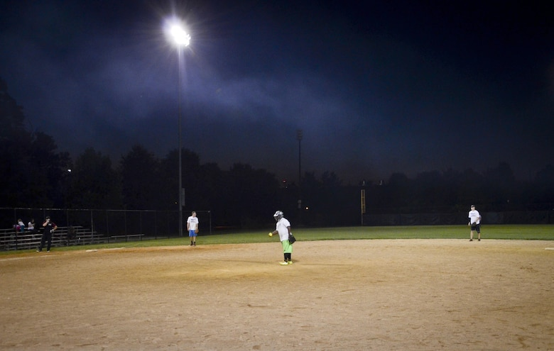 The Navy Information Operations Command defense gets ready for the 5th inning during the Game 2 Division ONE Intramural Softball Championship game against the 34th Intelligence Squadron, August 3, 2016 at Fort Meade, Md. The 34th IS went on to win the Championship game 31 to 25. (U.S. Air Force photo/Staff Sgt. AJ Hyatt)