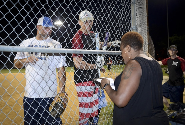 Softball players from the Navy Information Operations Command and the 34th Intelligence Squadron discuss the score with the scorekeeper during the Game 2 Division ONE Intramural Softball Championship game against the 34th Intelligence Squadron, August 3, 2016 at Fort Meade, Md. The 34th IS went on to win the Championship game 31 to 25. (U.S. Air Force photo/Staff Sgt. AJ Hyatt)