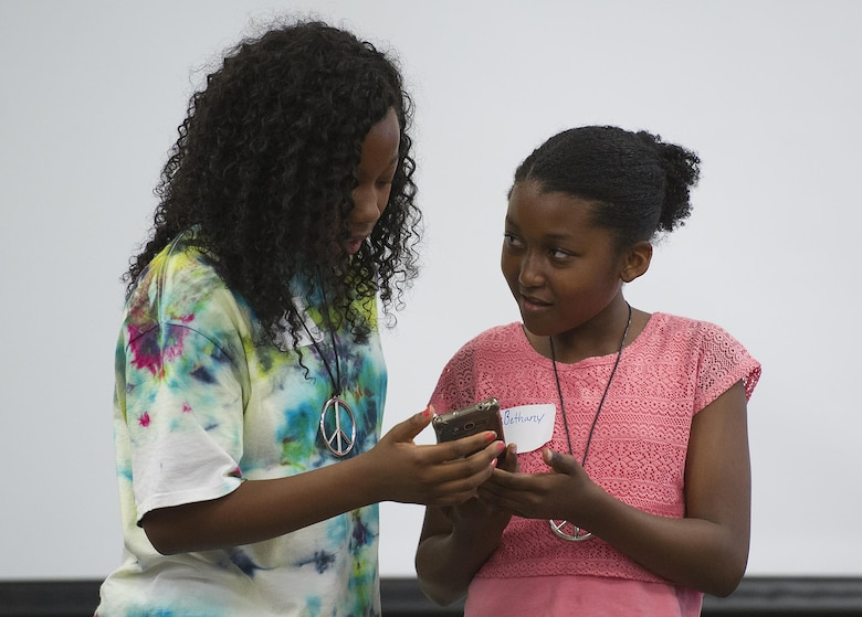 Khaliah Gorham and Bethany Sapp, both 11, act in a skit about cyber bullying during the Stop Bullying, Give Peace a Chance, anti-bullying event in the Wright-Patterson Air Force Base, Ohio, Religious Education Facility Aug. 2, 2016. Gorham, daughter of Sharron Griffin-Gorham, 88th Force Support Squadron; and Sapp, daughter of Yolanda and Gary Sapp, both with the 88th FSS; were demonstrating ways of dealing with attempts to be bullied. (U.S. Air Force photo/ R.J. Oriez)