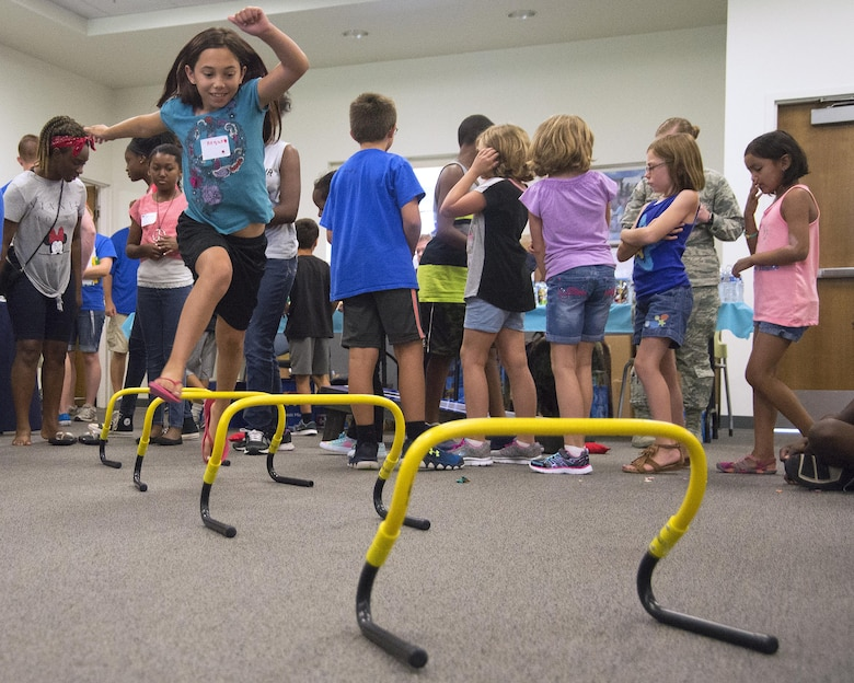 Regan Abbott, 10, races over hurdles during the Stop Bullying, Give Peace a Chance, anti-bullying event, Aug. 2, 2016, in the Religious Education Facility at Wright-Patterson Air Force Base, Ohio. The event was put together by the WBAFB School Liaison Officer in response to an increase in the reports of bullying at the end of last school year. Abbott lives with her father Capt. Scott Abbott, 35th Surgical Operations Squadron, in Misawa Air Base, Japan. (U.S. Air Force photo/R.J. Oriez)