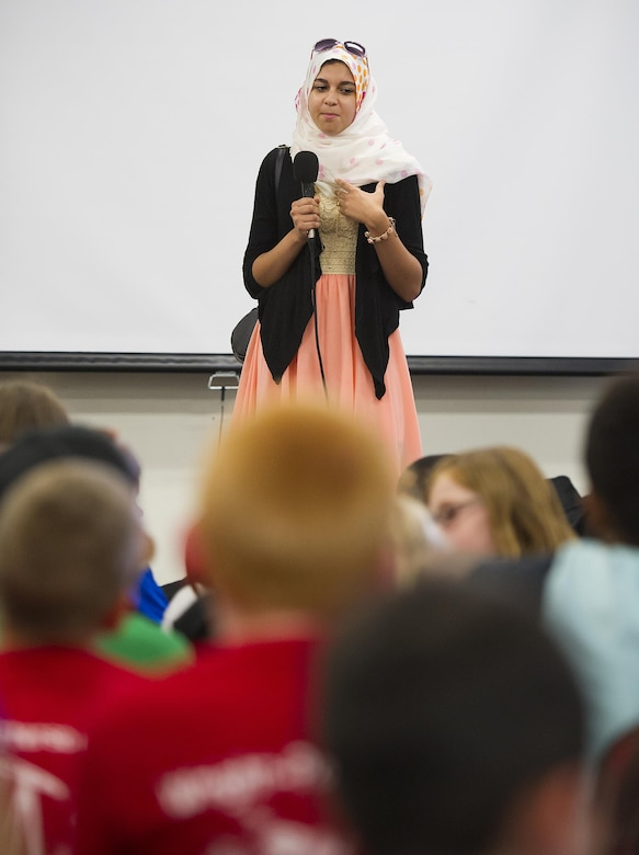 Fatima Boumahchad, 16, talks about the importance of bystander intervention to prevent bullying at the Stop Bullying, Give Peace a Chance, anti-bullying event in the Wright-Patterson Air Force Base, Ohio, Religious Education Facility Aug. 2, 2016. Boumahchad, who is starting her senior year at Dayton Regional STEM School, talked to 120 younger students attending the event sponsored by the WPAFB School Liaison Officer. (U.S. Air Force photo/R.J. Oriez)