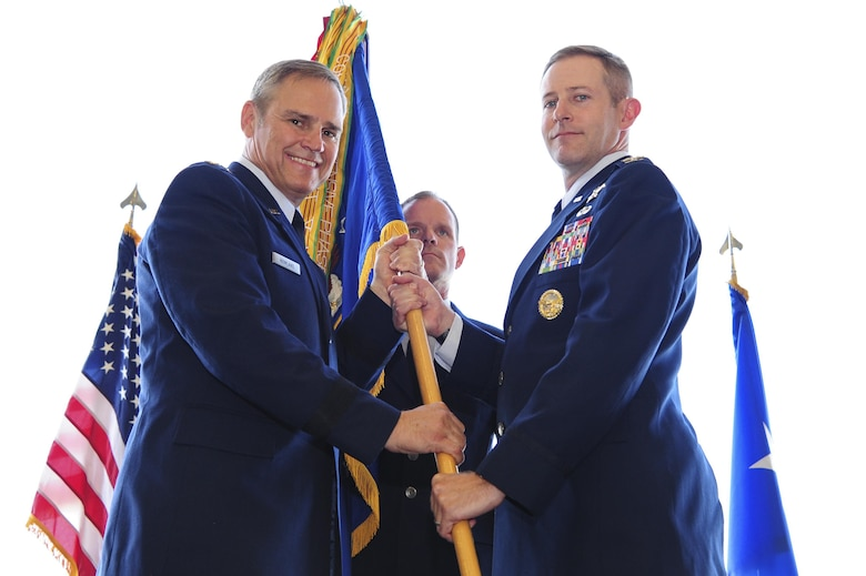 U.S. Air Force Lt. Gen. Chris Nowland, Twelfth Air Force (Air Forces Southern) commander, passes the 355th Fighter Wing guidon to Col. Scott Campbell during the unit's change of command ceremony at Davis-Monthan Air Force Base, Ariz., Aug. 5, 2016. Before assuming command of the 355th FW, Campbell served as the senior policy advisor to the Deputy Assistant Secretary of Defense for Afghanistan, Pakistan and Central Asia. (U.S. Air Force photo by Senior Airman Chris Drzazgowski)