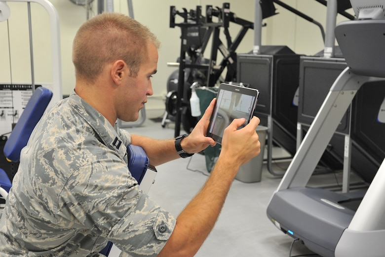 Capt. Nathan Howarth, 17th Medical Operations Squadron Services Flight Commander, films a participant's running technique during a running clinic at the Carswell Field House on Goodfellow Air Force Base, Texas, July 27, 2016. The monthly clinic helps service members improve their technique and to prevent injuries. (U.S. Air Force photo by Staff Sgt. Laura R. McFarlane/Released)