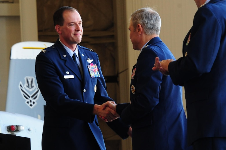 U.S. Air Force Col. James Meger, 355th Fighter Wing commander, shakes hands with Lt. Gen. Chris Nowland, Twelfth Air Force (Air Forces Southern) commander, after making his remarks as outgoing commander during a change of command ceremony at Davis-Monthan Air Force Base, Ariz., Aug. 5, 2016. Meger relinquished his command of the 355th FW bringing a close to his 24-year-long career in the USAF. (U.S. Air Force photo by Senior Airman Chris Drzazgowski)