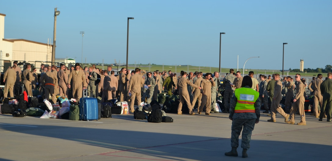More than 250 warfighters from the 552nd Air Control Wing Wing wait to be cleared through customs following their return from deployment to southwest Asia July 21.