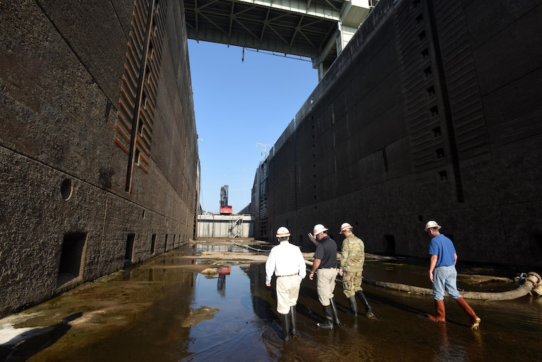 Congressman Chuck Fleischmann (Left), Tennessee District 3, walks through the grit, grime and pools of water inside the dewatered Chickamauga Lock Aug. 3, 2016 during a visit to see firsthand the condition of the lock while U.S. Army Corps of Engineers Nashville District personnel repair the components, valves and gates that deteriorate under the 11 million gallons of water the lock holds.