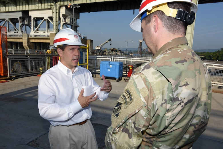 Congressman Chuck Fleischmann (Left), Tennessee District 3, and Lt. Col. Stephen Murphy, U.S. Army Corps of Engineers Nashville District commander, talk about the condition of Chickamauga Lock during a visit to the lock located on the Tennessee River in Chattanooga, Tenn.  The congressman donned a pair of rubber boots and received a briefing inside the dewatered lock chamber from a team of maintainers that are inspecting and repairing the components, valves and gates that normally operate under water.