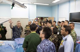 Cmdr. Dennis Spence, an anesthesiologist assigned to USNS Mercy (T-AH 19), conducts a tour of an operating room for heads of delegation from the Asia Pacific Military Health Exchange (APMHE) during a tour aboard Mercy. Mercy is in Malaysia for Pacific Partnership 2016, the first time the mission has visited Malaysia. Partner nations are working side-by-side with local organizations in a search and rescue exercise, civil engineering projects, community relation events and subject matter expert exchanges.