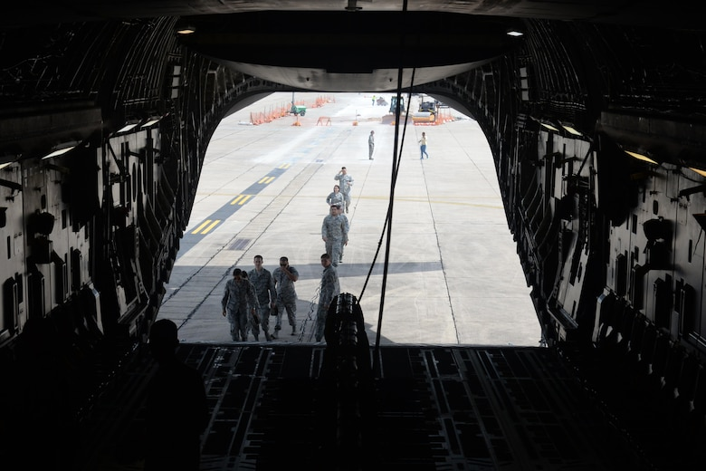 Members of Keesler Air Force Base board a C-17 Globemaster III for an incentive flight Aug. 4, 2016, at Keesler AFB, Miss. The incentive flight was part list of a weeklong hurricane exercise to prepare Keesler for the current hurricane season.  (Air Force Photo by Airman 1st Class Travis Beihl/Released)