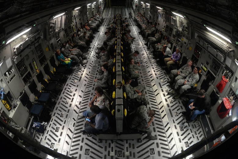 Members of Keesler Air Force Base wait for takeoff on a C-17 Globemaster III during an incentive flight Aug. 4, 2016, at Keesler AFB, Miss. The incentive flight was part of a weeklong hurricane exercise to prepare Keesler for the current hurricane season. (Air Force Photo by Airman 1st Class Travis Beihl/Released)
