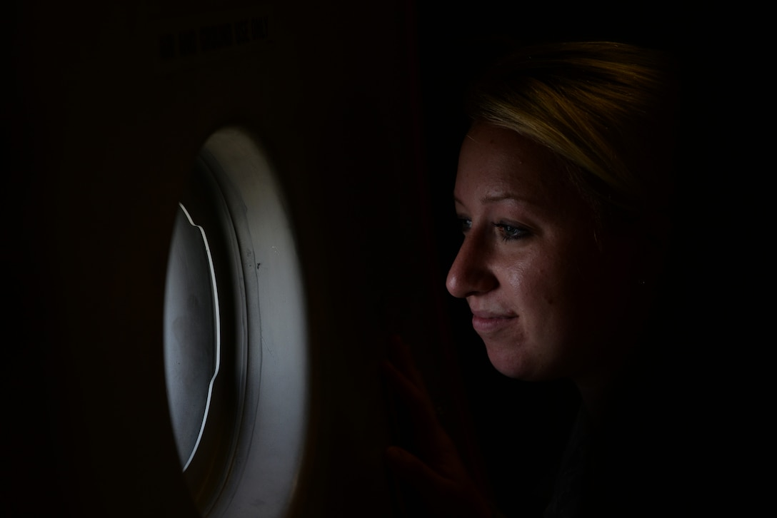 Senior Airman Jessica Jarosz, 81st Dental Squadron dental assistant, looks out a window on a C-17 Globemaster III during an incentive flight Aug. 4, 2016, at Keesler Air Force Base, Miss. The incentive flight was part of a weeklong hurricane exercise to prepare Keesler for the current hurricane season. (Air Force Photo by Airman 1st Class Travis Beihl/Released)