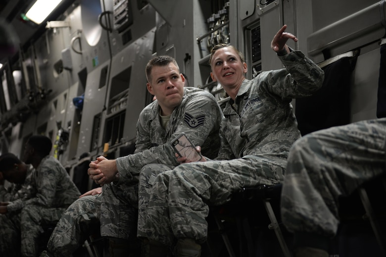 Staff Sgt. Craig Schauble, 334th Training Squadron air traffic control instructor, and Tech. Sgt. Jennifer Harper, 81st Training Wing equal opportunity specialist, share a conversation during an incentive flight Aug. 4, 2016, at Keesler Air Force Base, Miss. The incentive flight was part of a weeklong hurricane exercise to prepare Keesler for the current hurricane season. (Air Force Photo by Airman 1st Class Travis Beihl/Released)