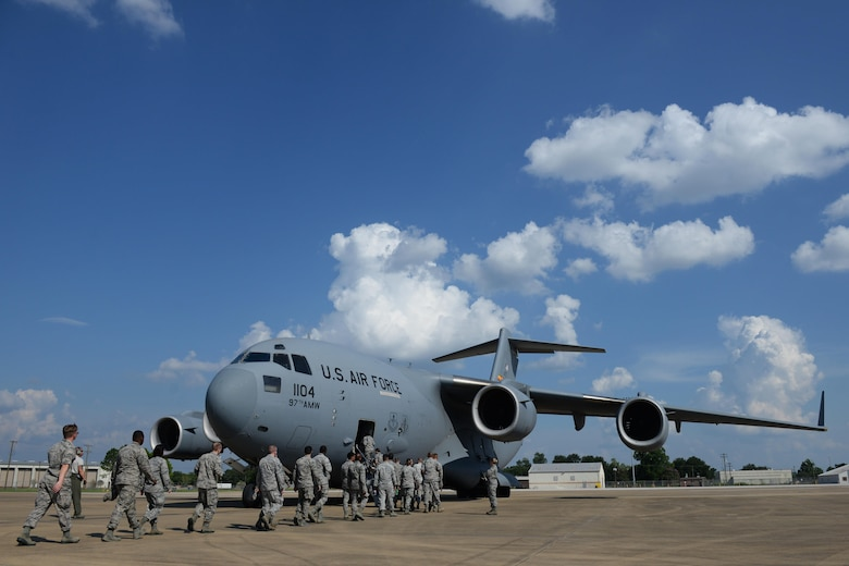 Members of Keesler Air Force Base board a C-17 Globemaster III for an incentive flight Aug. 4, 2016, at Fort Polk, La. The incentive flight was part of a weeklong hurricane exercises to prepare Keesler for the current hurricane season.  (Air Force Photo by Airman 1st Class Travis Beihl/Released)