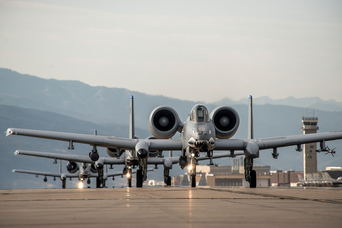 A-10 Thunderbolt II aircraft from Moody Air Force Base, Ga. taxi prior to takeoff Aug. 3 at Hill AFB. Moody Airmen and aircraft are at Hill participating in a combat exercise known as Combat Hammer. The exercise evaluates the performance of precision weapons and measures their suitability for use in combat. (U.S. Air Force photo by Paul Holcomb)