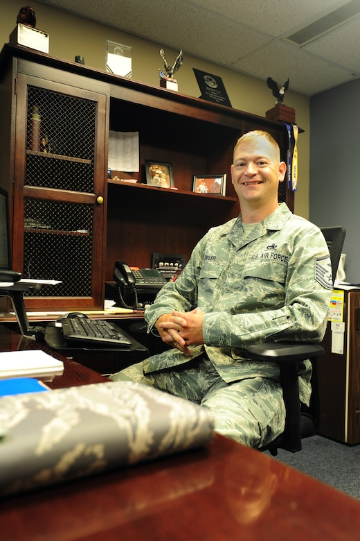 Master Sgt. Justin Tayler, 341st Missile Wing Staff Agency and Operations Group first sergeant, poses in his office Aug. 1, 2016, at Malmstrom Air Force Base, Mont. The first sergeant's role in the Air Force is one that is time-honored, rich in customs and traditions; they derive authority from unit commanders and are a critical link in providing a mission-ready enlisted force. (U.S. Air Force photo/2nd Lt. Annabel Monroe)