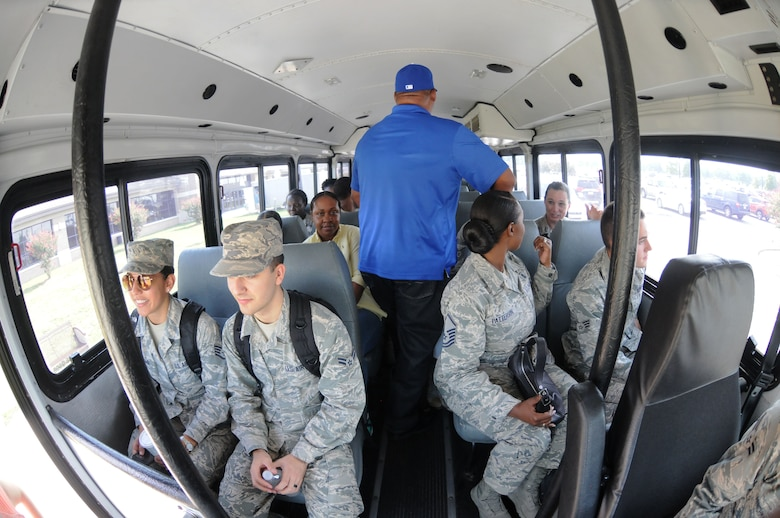 Keesler personnel board a bus at the Base Exchange to evacuate during a hurricane exercise Aug. 4, 2016, on Keesler Air Force Base, Miss. The purpose of the exercise was to prepare Keesler for the current hurricane season. (U.S. Air Force photo by Kemberly Groue/Released)