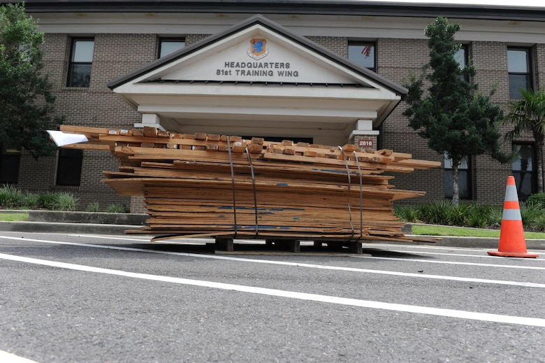 A pallet of boarding materials are placed in front of the 81st Training Wing headquarters building for securing doors and windows during a hurricane exercise Aug. 3, 2016, on Keesler Air Force Base, Miss. The purpose of the exercise was to prepare Keesler for the current hurricane season. (U.S. Air Force photo by Kemberly Groue/Released)