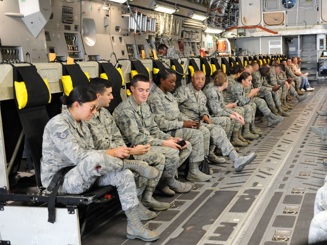 Keesler personnel sit aboard a C-17 Globemaster III from Altus Air Force Base, Okla. for evacuation during a hurricane exercise Aug. 4, 2016, on Keesler Air Force Base, Miss. The purpose of the exercise was to prepare Keesler for the current hurricane season. (U.S. Air Force photo by Kemberly Groue/Released)